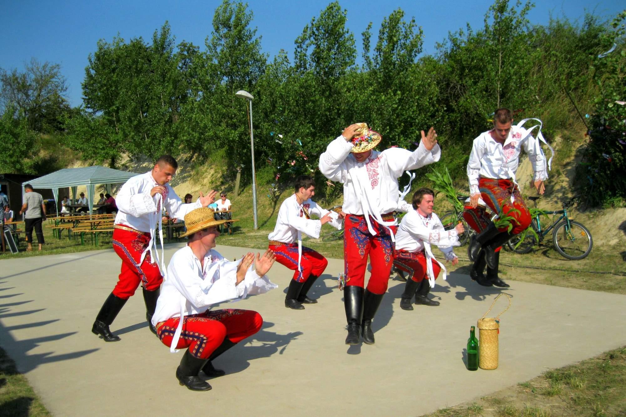 Chasa dancing in folk costumes.